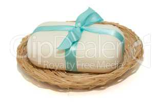 isolation photo of soap with a bow in a basket on a white backgr
