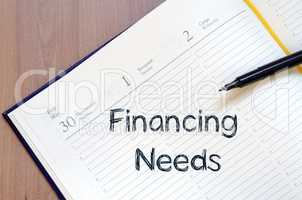 Financing needs write on notebook