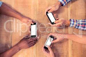 Overhead view of business people using smart phones