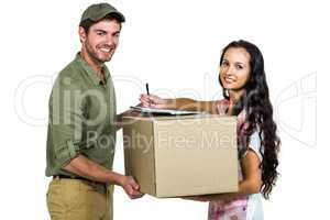 Woman signing for pack delivery with smiling postman