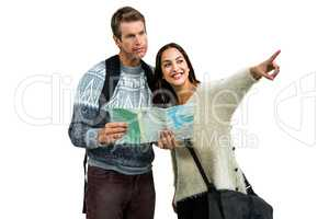 Woman traveling with boyfriend pointing while holding map