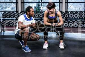 Fit woman discussing performance with trainer