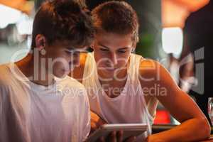 Teenagers watching something on touch pad