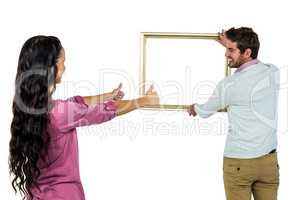 Smiling couple with picture frame
