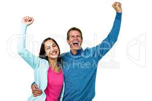 Successful couple with hands raised