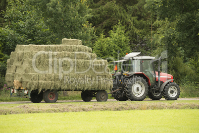 Transportation of bales of hay.