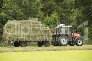 Transportation of bales of hay.