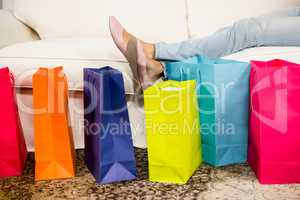 Shopping bags against sofa