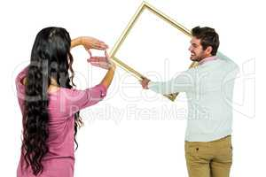 Happy couple holding picture frame