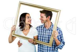 Couple holding picture frame