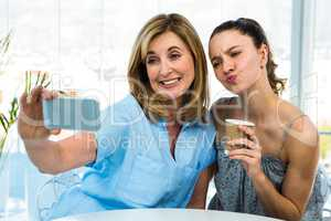 mother and daughter take selfie