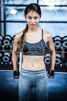Fit woman with clenched fist