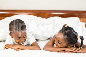 Brother and sister lying in the bed