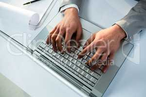 Close up view of businessman using laptop computer