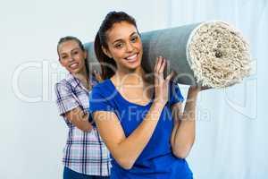Friends holding a carpet