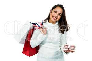 Portrait of happy woman with shopping bags and footwear