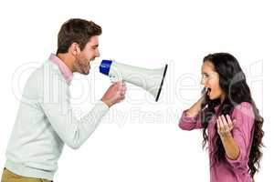 Screaming couple  with man holding loudspeaker