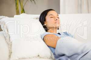 Sleeping brunette on the sofa