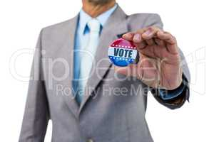 Businessman holding a badge