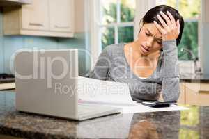 Worried brunette counting bills