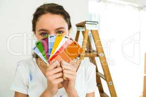 girl showing color samples