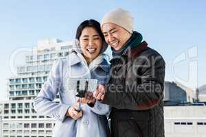 Couple laughing while viewing pictures
