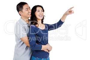 Happy couple with woman pointing up