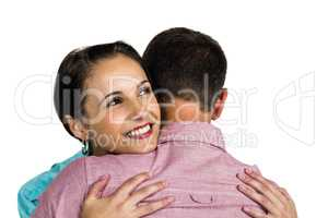 Beautiful woman hugging boyfriend