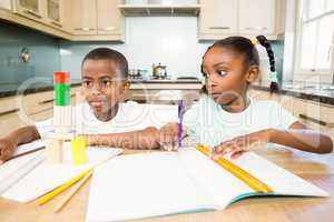 Children doing homework in the kitchen