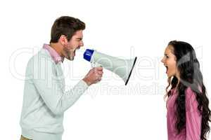 Shouting couple with man holding loudspeaker