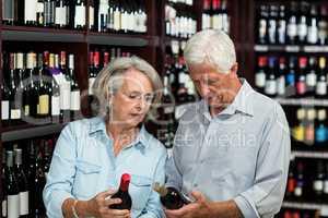 Smiling senior couple choosing wine