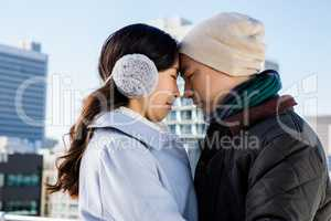 Affectionate couple in warm clothing