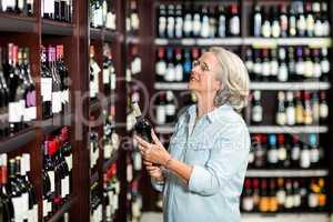 Senior woman choosing wine