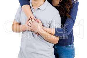 Mid section of loving woman embracing man