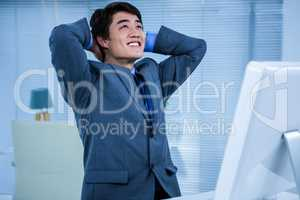 Relaxed businessman look up