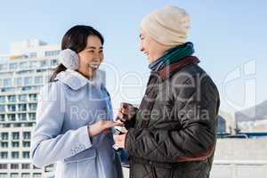 Boyfriend proposing cheerful girlfriend