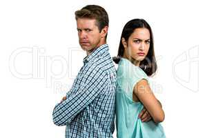 Portrait of angry couple standing back to back