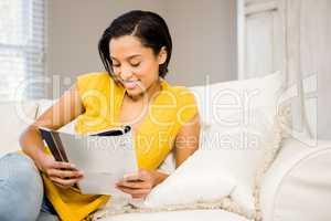 Smiling brunette reading document