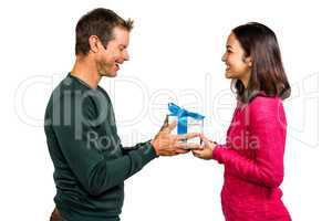 Girlfriend taking gift from boyfriend