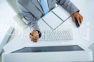Businessman pointing at computer monitor