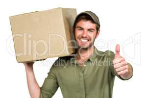 Handsome postman holding pack showing thumbs up