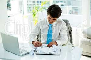 Busy asian businessman writing
