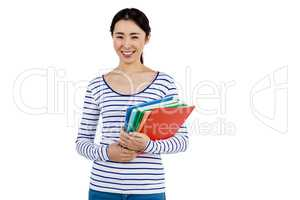 Cheerful woman holding files