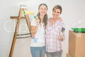 Mother and daughter redecorating a room