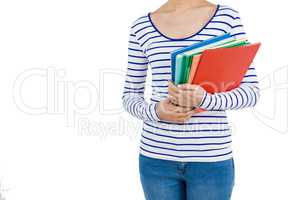Mid section of woman holding files