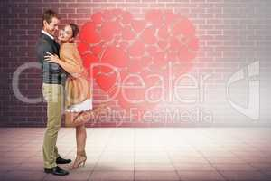 Composite image of full length of romantic couple hugging