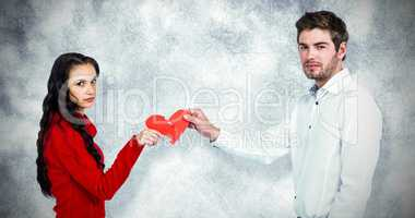 Composite image of portrait of couple holding red cracked heart