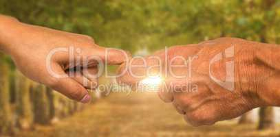 Composite image of cropped hands of people holding fingers