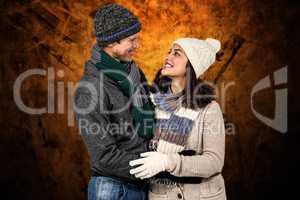 Composite image of winter couple enjoying hot drinks