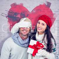Composite image of smiling woman covering partners eyes and hold